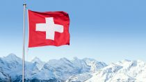 Swiss Flag Flying Over Alpine Scenery