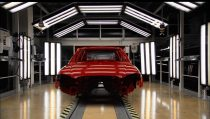 Photo: Illuminated red chassis on assembly line