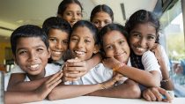 Faces of laughing students from the Shri Venkataramana Higher Primary School