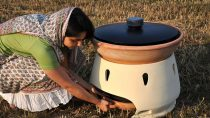 Woman with solar-powered water distiller
