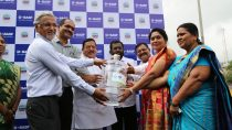 Raman Ramachandran (left), Managing Director of BASF India Limited and Head South Asia, along with other dignitaries presenting the first water can to beneficiaries at NMMC School No. 22 in Turbhe under the BASF Landmark Project.